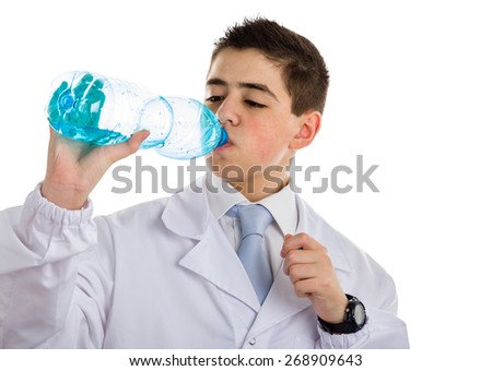 A boy doctor in blue tie and white coat with black digital watch drinking water from plastic bottle. His acne skin has not ben retouched
