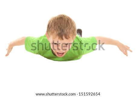a boy flying through the air with a happy freaked out expression on his face.