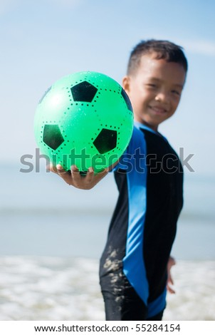 A boy hold the ball - stock photo