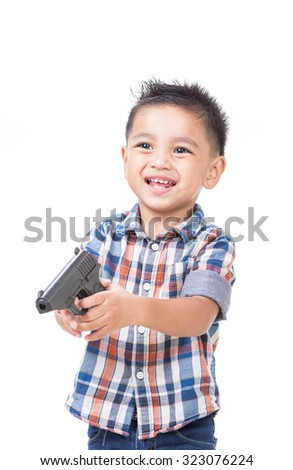 A boy holding a toy gun on a white background.