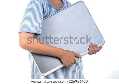 A boy holding laptop - stock photo