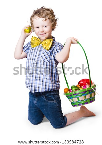A boy hunting Easter eggs with a green wicker basket