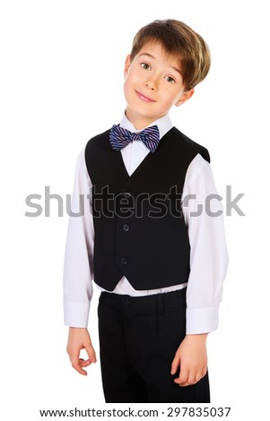A boy in a suit. Fashion kids. Education. Isolated over white.