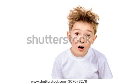A boy in white t-shirt stares into the camera, he is surprised. Isolated over white background. - stock photo