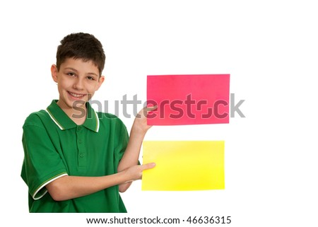 A boy is holding red and yellow sheets of paper in his hands; isolated on the white background