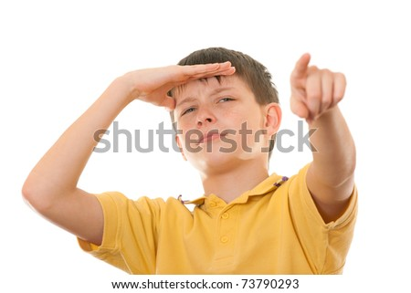 A boy is looking forward and pointing a distant object; isolated on the white background - stock photo