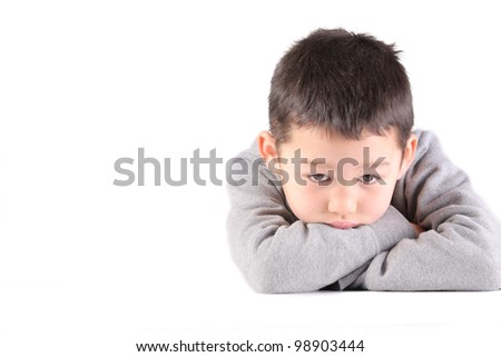 A boy is sad, depressed, thinking something and not looking at the camera - stock photo