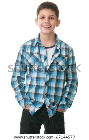 A boy is standing with his hands inside his jeans; isolated on the white background - stock photo