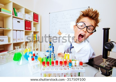 A boy is studying in the laboratory. He is shocked and surprised. Science and education. School.