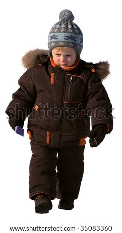 A boy of three years in winter clothes with a concentrated expression of a serious person. Isolated on a white back