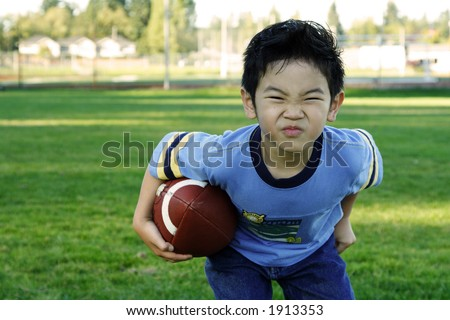 A boy playing football outdoor
