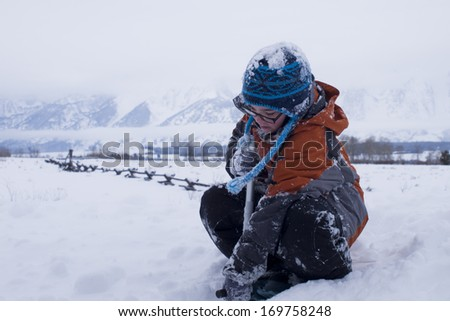 A boy playing in the snow.