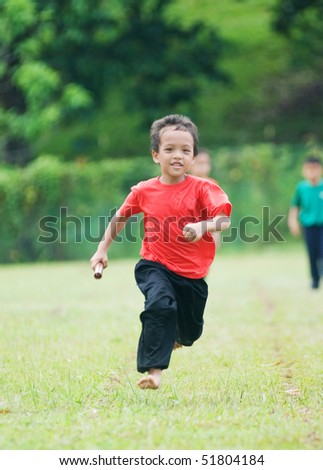 a boy run for victory - stock photo