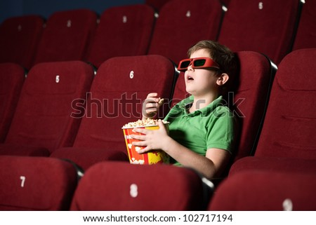 A boy sitting in the row alone - stock photo