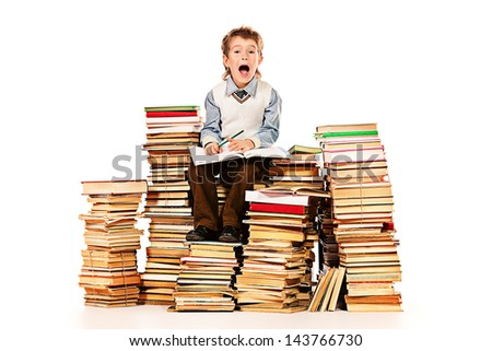A boy sitting on a pile of books and shouting. Education. Isolated over white.