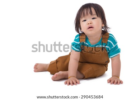 A boy sitting on a white background. - stock photo