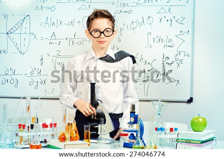 A boy tired of working in the laboratory. Science and education. School. - stock photo