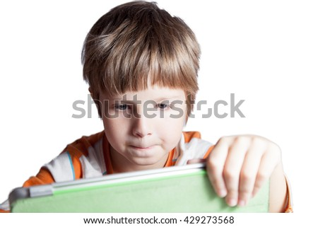 A boy who is engaged with a tablet computer - stock photo