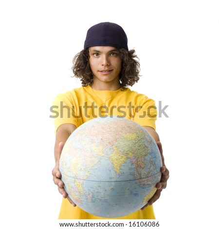 A boy with a cap holds out a globe