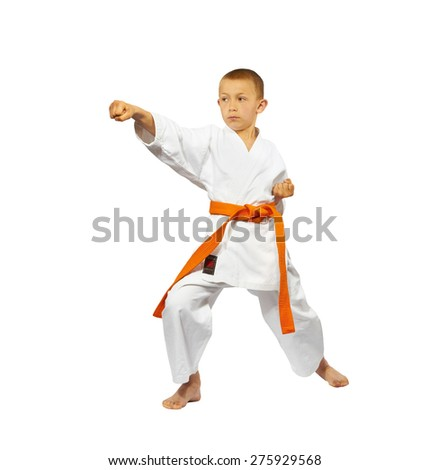 A boy with a red belt makes punch