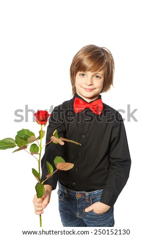 A boy with a red rose in her hand standing on white background