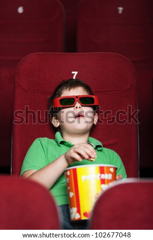 A boy with a snack at the cinema