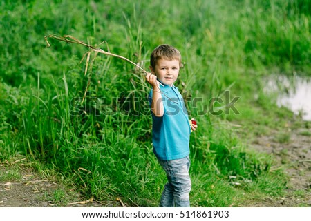 a boy with a stick on a green background