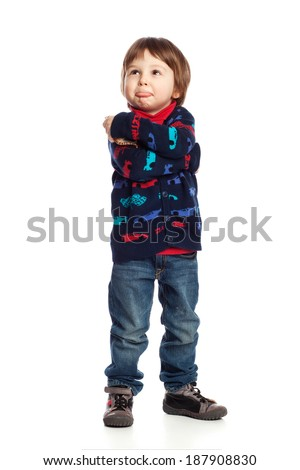 A boy with arms crossed pretending to be unhappy, isolated on white - stock photo
