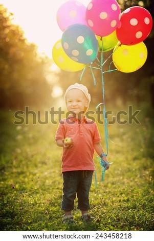 A boy with ballons - stock photo