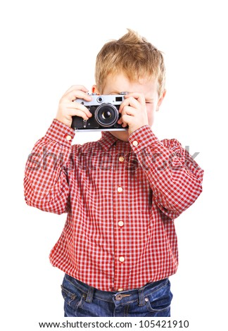 A boy with camera on white background