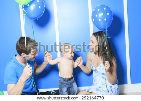 A Boy with colorful balloons in is bedroom - stock photo