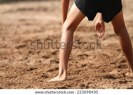 A boys playing beach volleyball - stock photo