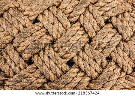 A braided used rope texture - stock photo