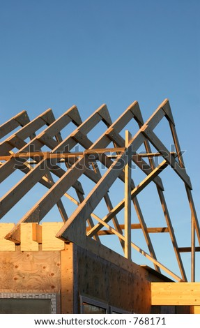 A brand new home in the process of being built - stock photo