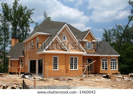 A brand new home still under construction. - stock photo