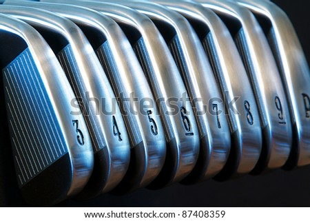A brand new set of golf club irons - stock photo