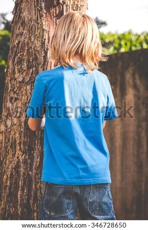 a brat little boy - rebuke - stock photo