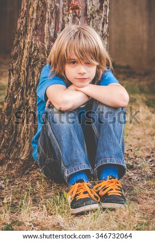 a brat little boy - sadness - stock photo