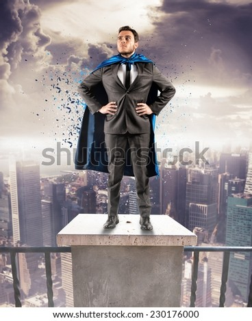 A brave businessman hero above the skyscrapers - stock photo