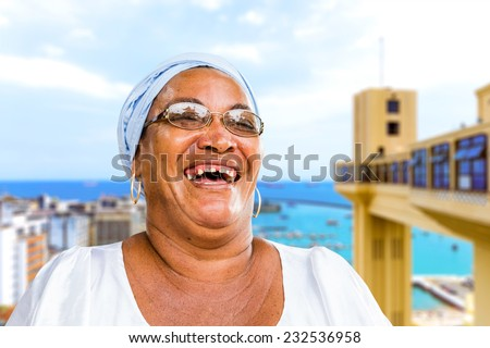 A Brazilian woman of African descent, smiling, wearing traditional clothes in Salvador, Bahia