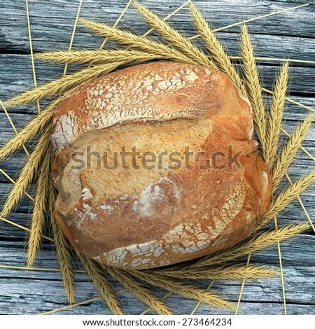 A bread campaign on a wooden and old table surrounded by wheat ears. We can almost smell, touch and eat this bread. - stock photo