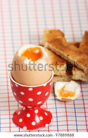 A breakfast favorite of boiled egg and soldiers - stock photo