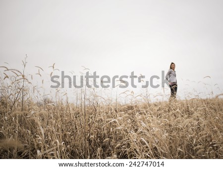 A breath of Iowa with a model on the horizon. - stock photo