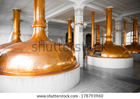 a brewery building interior, container cooking pots - stock photo