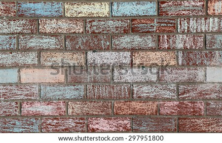 A brick wall at a school covered with colored chalk.  - stock photo