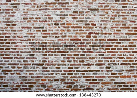 A brick wall newly fitted with concrete seam. - stock photo
