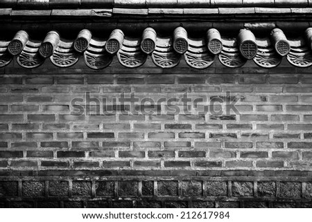 A brick wall of a Korean historical palace in black and white - stock photo