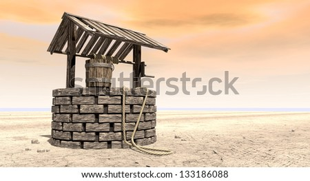 A brick water well with a wooden roof and bucket attached to a rope in a flat barren landscape with an orange sky - stock photo