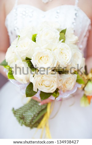 A bride, holding a bouquet of flowers