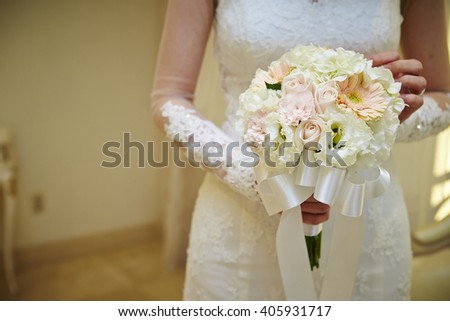 A bride holding a wedding bouquet